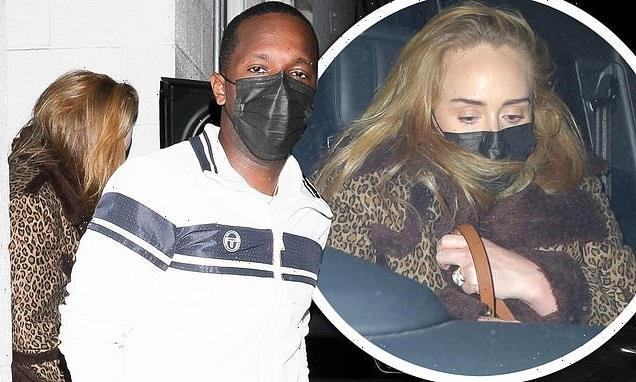 Adele andRich Paul sneak out the back exit of swankyLA restaurant